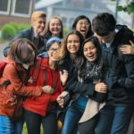 Group of happy students on the yard of the campus
