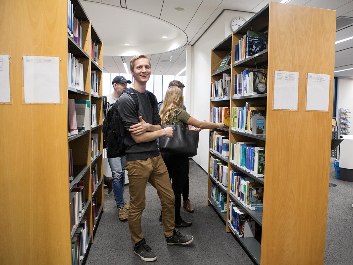 Library customers between shelves