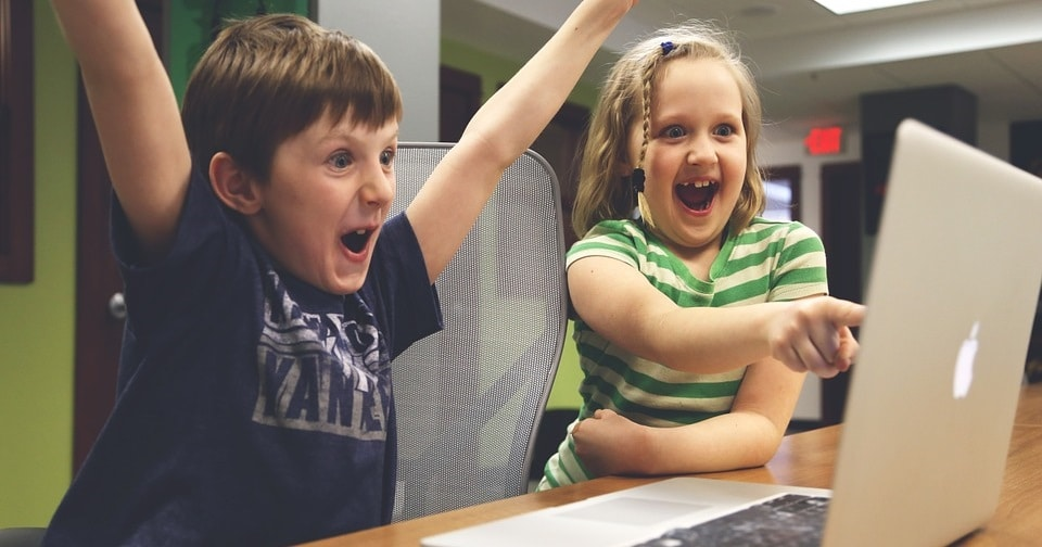 Children excited on computer