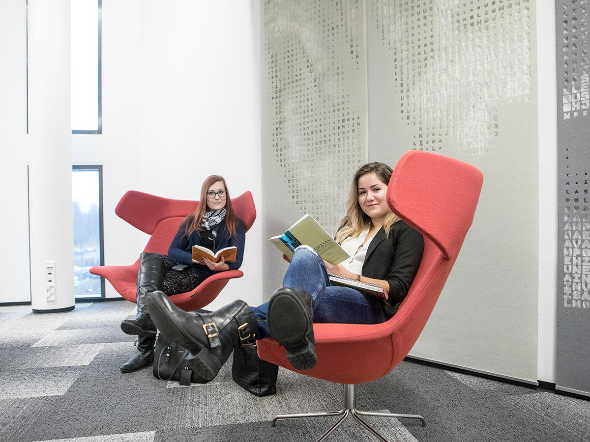 Two students sitting in a lobby