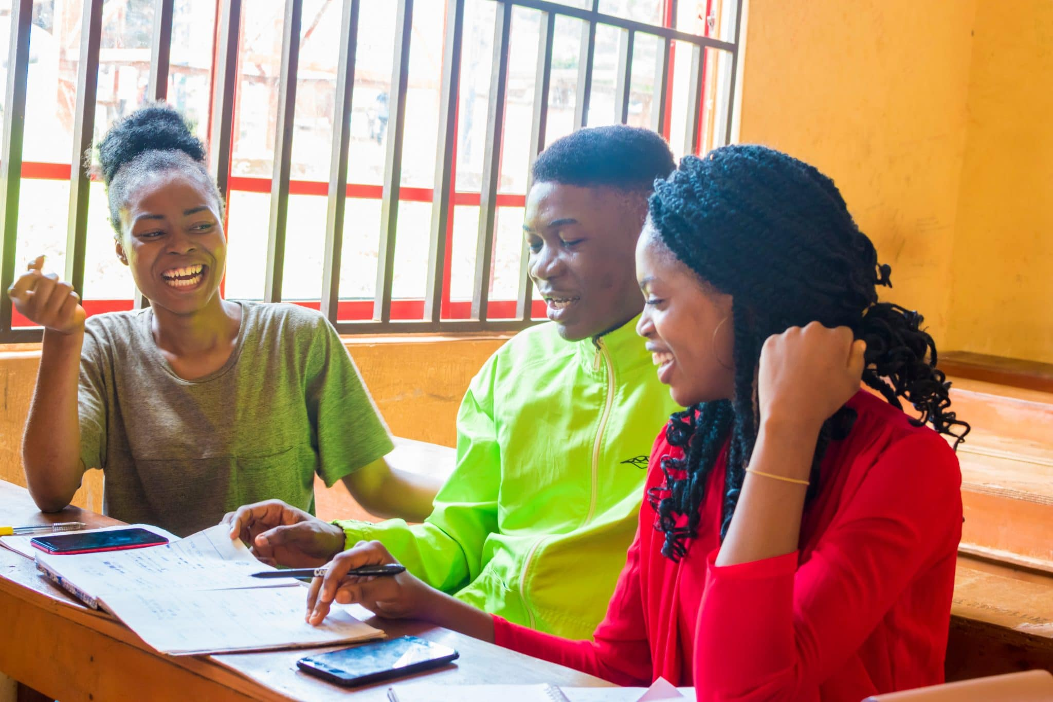 Three young Africans studying together